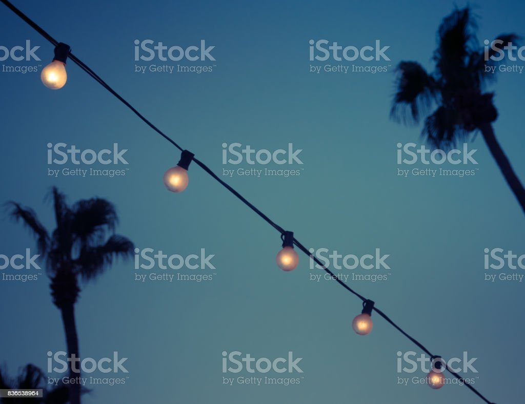 Outdoor String Garland Light Bulbs in Evening stock photo