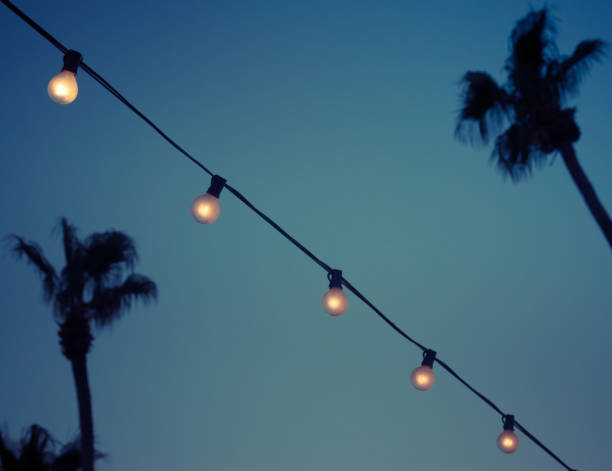 Outdoor String Garland Light Bulbs in Evening stock photo