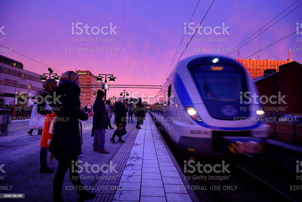 Outdoor subway train station platform winter sunset stock photo