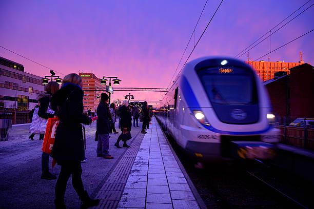 outdoor subway train station platform winter sunset - waiting for a train sweden bildbanksfoton och bilder