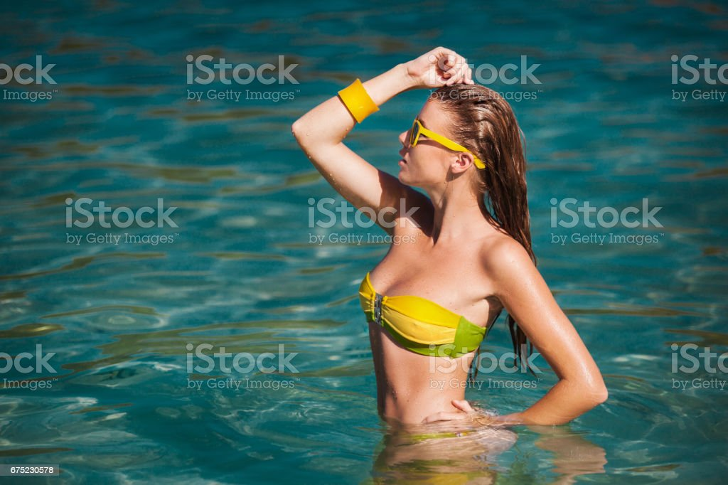 Outdoor summer portrait of young pretty woman in bikini near the sea at tropical beach. royalty-free stock photo
