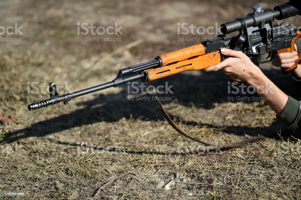 Outdoor target shooting with assault rifle in a shooting range