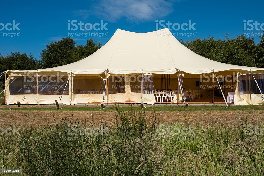Outdoor rental tent in a filed for a wedding or event