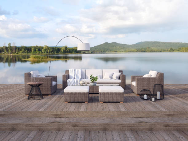 Outdoor terrace living area with beautiful lake and mountain view 3d render stock photo