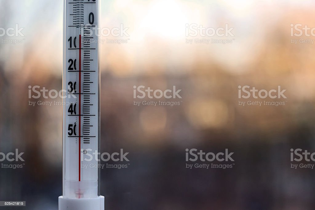 Outdoor thermometer with negative mark temperature on blurred background stock photo