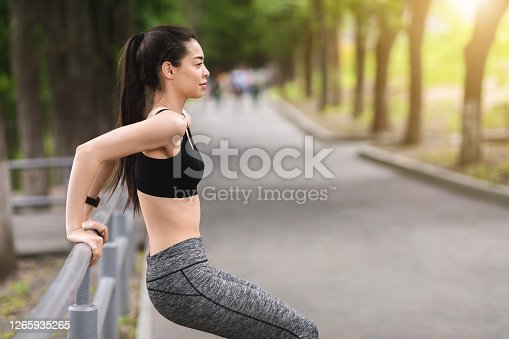 Outdoor Training. Motivated Asian Girl Exercising With Handrail In Park, Making Bodyweight Push Ups, Copy Space
