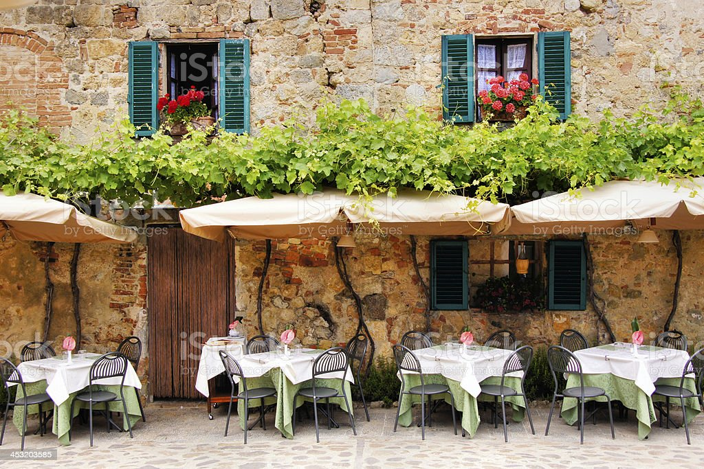 Outdoor trattoria in a quiant village in Tuscany, Italy royalty-free stock photo