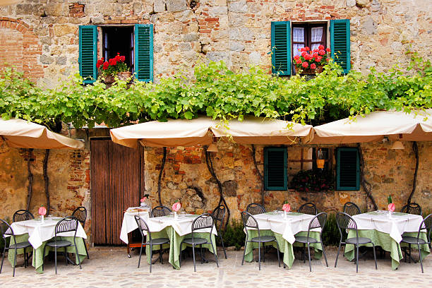 Outdoor trattoria in a quiant village in Tuscany, Italy stock photo