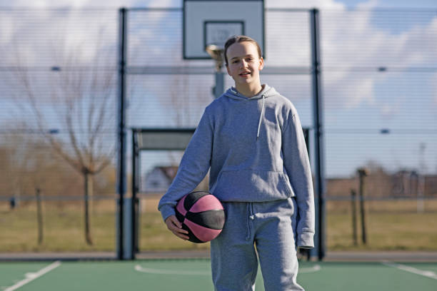 Outdoor urban basketball training session for individual female teenage girl streetball player stock photo