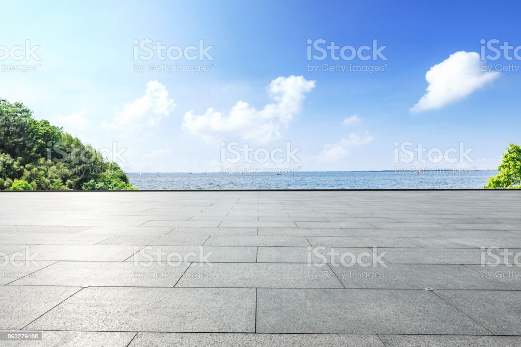 Outdoor viewing platform and lake landscape under the blue sky stock photo