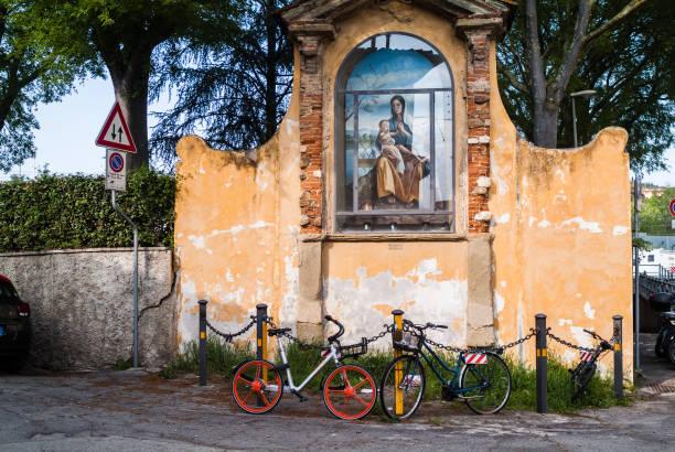 outdoor virgin mary's assumption statue with bikes - ferragosto foto e immagini stock
