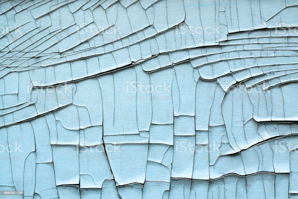 Outdoor wall with a white peeling paint. stock photo