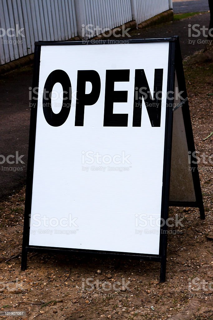 Outdoor white board sign 'OPEN' with copy space royalty-free stock photo