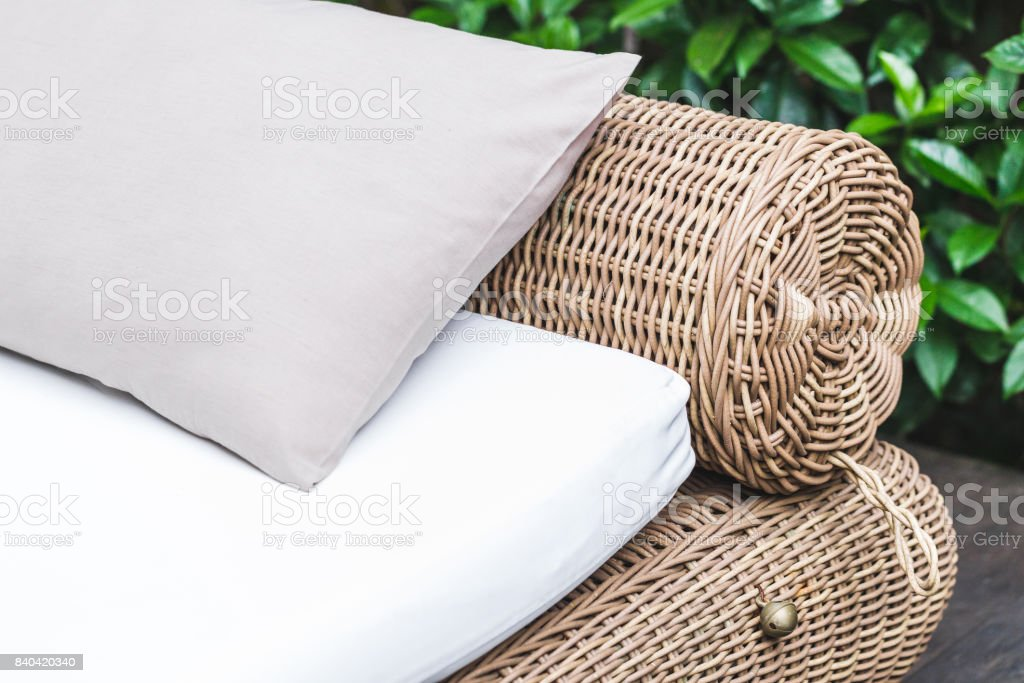 Outdoor Wicker Bed With White Mattress And Grey Pillow Clean Place