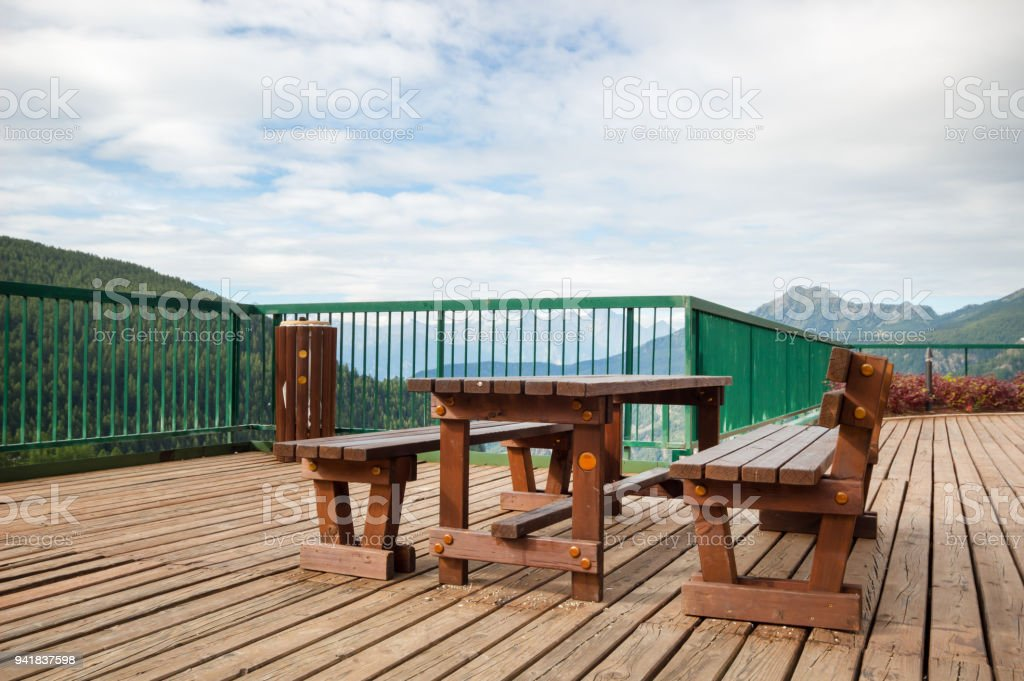 Pleasing Outdoor Wood Bench Chair And Wood Table On Wood Floor In The Pabps2019 Chair Design Images Pabps2019Com