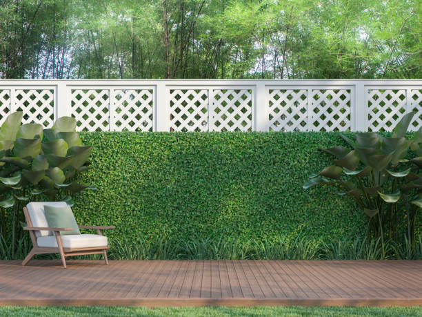 Outdoor wood terrace in the garden 3d render Outdoor wood terrace in the garden 3d render,  There is a wooden floor terrace,white fence,furnished with wood and white fabric furniture. lawn stock pictures, royalty-free photos & images