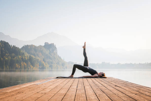 Outdoor Yoga on Misty Lake Bled in Morning stock photo