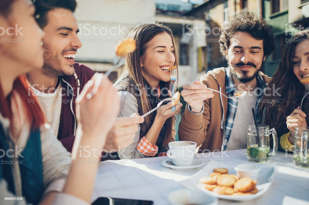 Outdoors brunch with friends stock photo