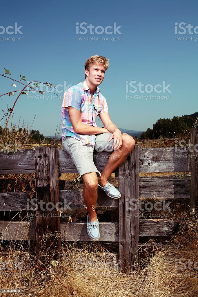 Outdoors Casual Male in Fence Area royalty-free stock photo