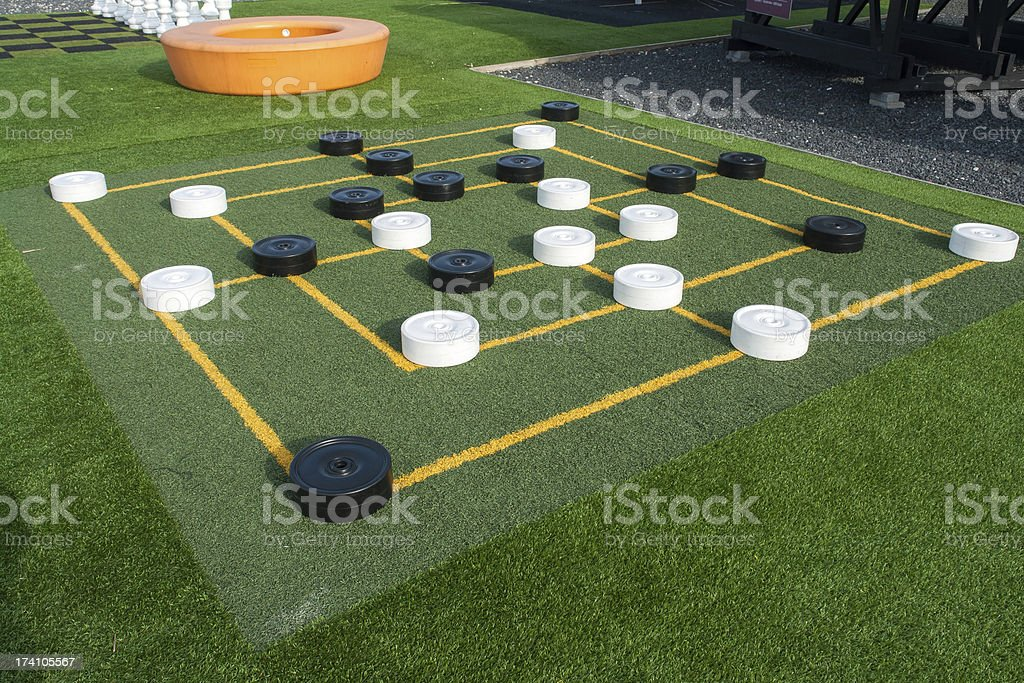 Outdoors draughts checkers board game royalty-free stock photo