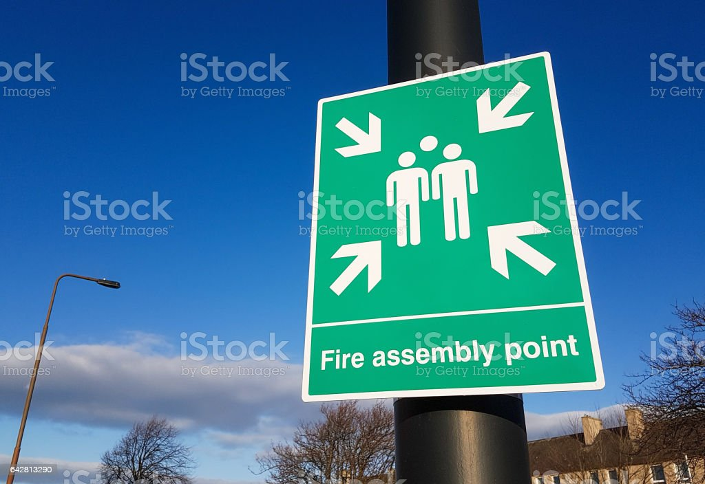 Outdoors Fire Assembly Point sign outdoors stock photo