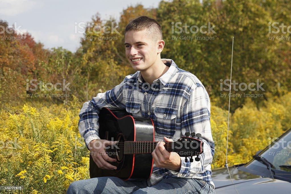 Outdoors guitar fun. royalty-free stock photo