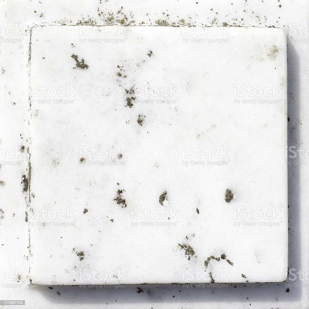 Weathered raised white marble tile stone square stock photo