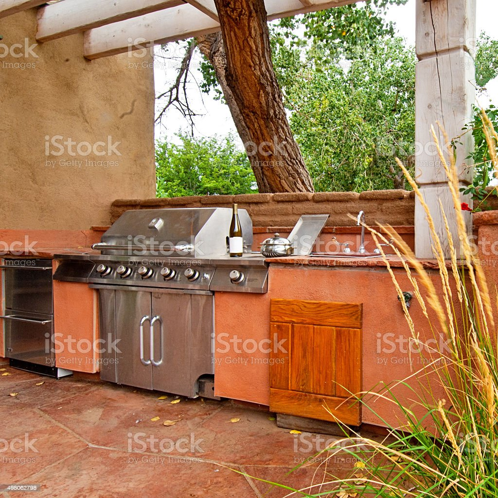 Outdoors Kitchen with Built-In gas grill on a deck stock photo