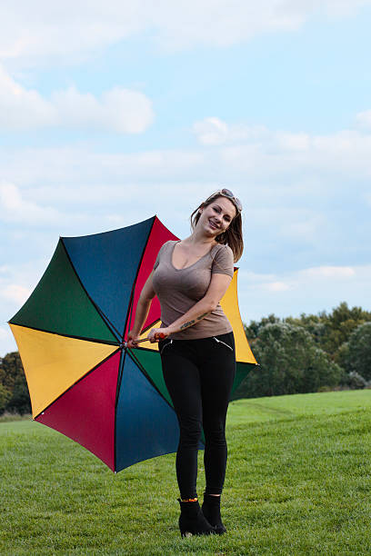 happy with rainbow umbrella shapely outdoor polish girl - whiteway polish outdoor girl stock photos and pictures