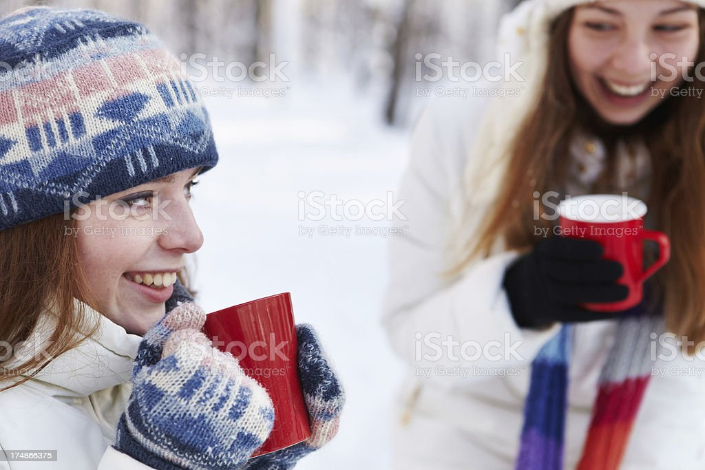 Outdoors on a winter day Girls drink tea royalty-free stock photo