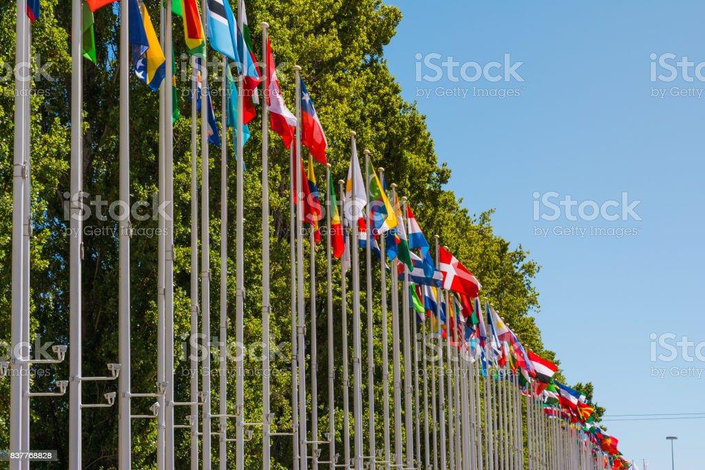 Outdoors Park Area International Flag DIsplay Blue Sky Background stock photo