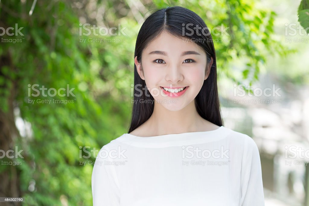 outdoors portrait of beautiful young brunette girl. stock photo