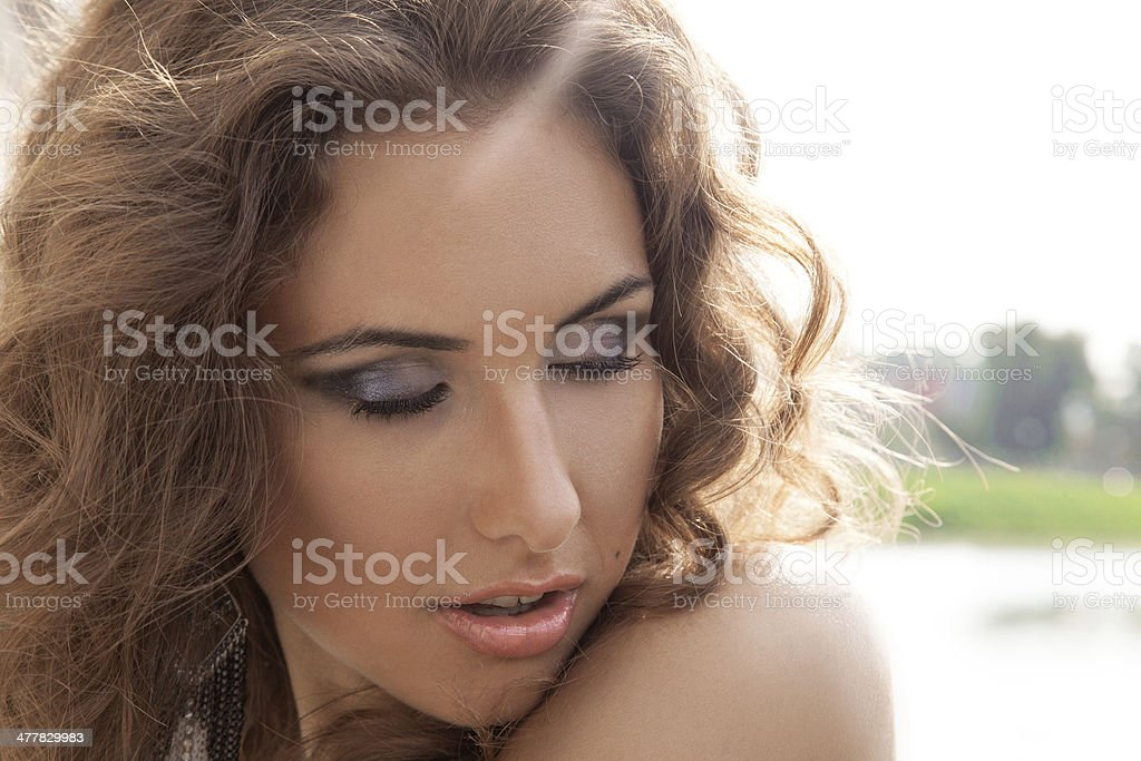 Outdoors portrait of female with closed eyes royalty-free stock photo