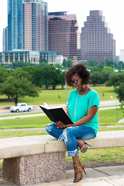 outdoors reading - charming stock photos and pictures