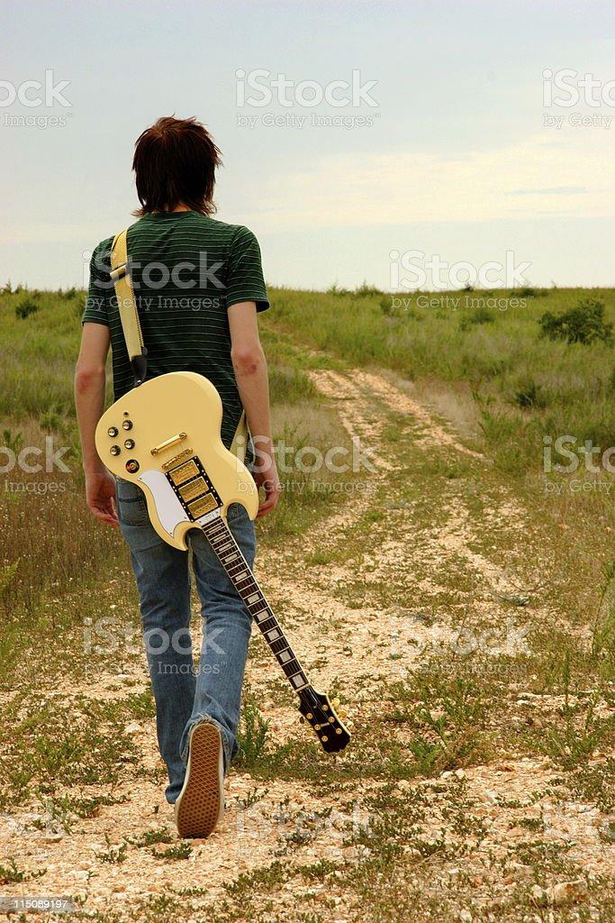 outdoors series - teen rocker on dirt road royalty-free stock photo