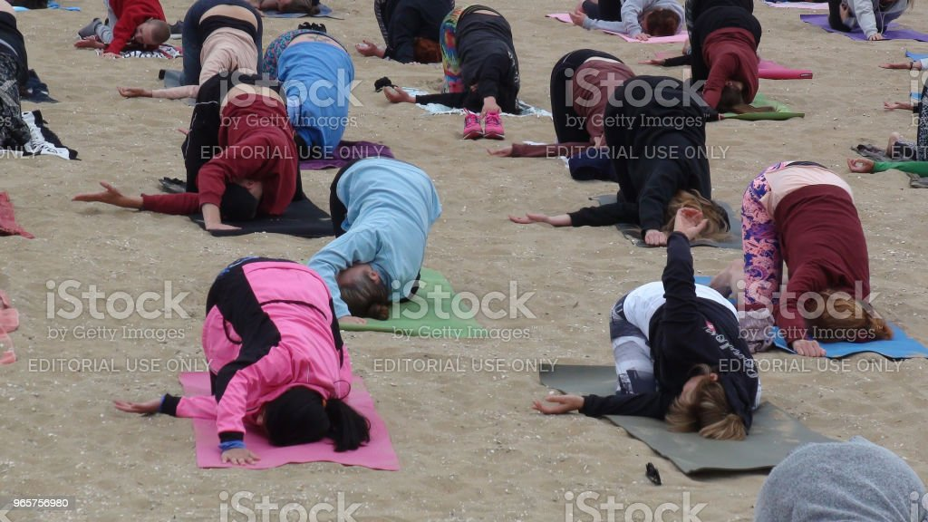 Outdoors Yoga Exercise For Health And Relaxation Class - Royalty-free Beach Stock Photo