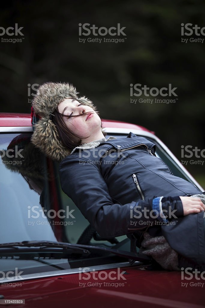 Outdoorsy Girl Napping on Pickup Hood royalty-free stock photo