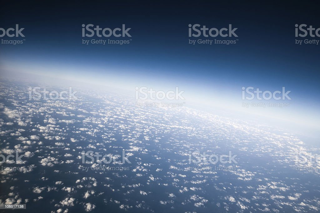 Outer space view of clouds over planet earth stock photo