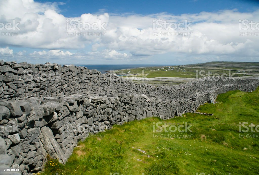 Outer Wall of Dun Aonghasa (Dun Aengus) with Island Landscape stock photo