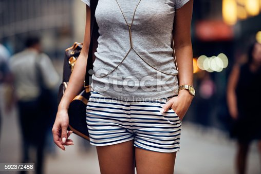 istock Outfit details of fashion elegant stylish woman posing outdoors 592372486