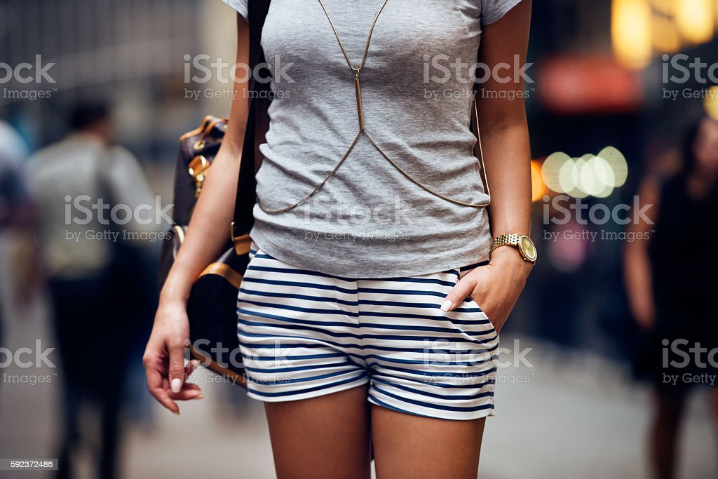 Outfit details of fashion elegant stylish woman posing outdoors stock photo