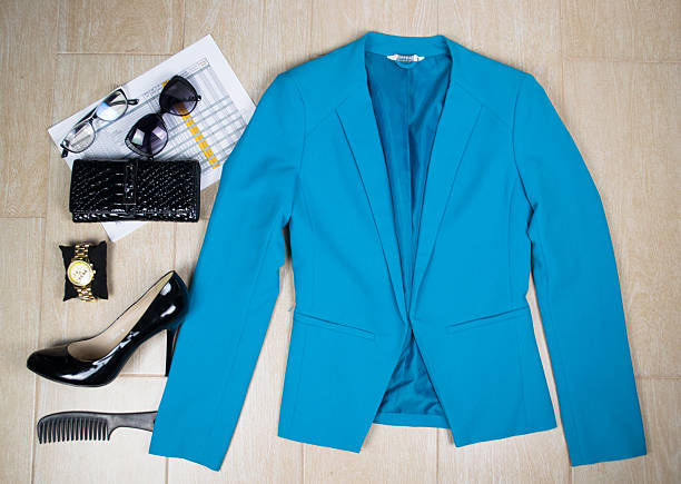 Outfit of clothes and woman accessories. Overhead of essentials business woman. stock photo