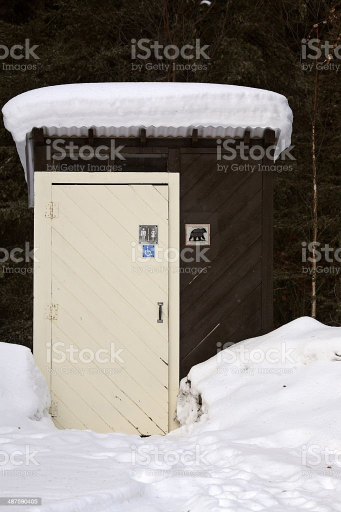 Outhouse at Waskesui Lake in winter stock photo