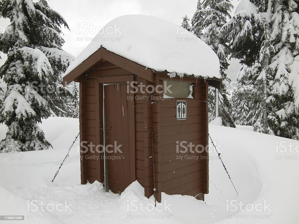 Outhouse in Snow stock photo