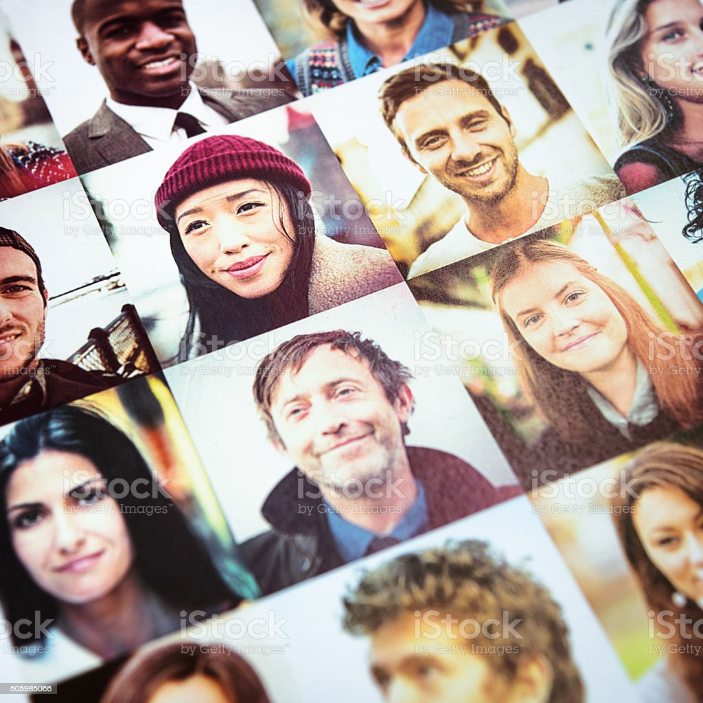 Outlay of multiracial faces printed stock photo