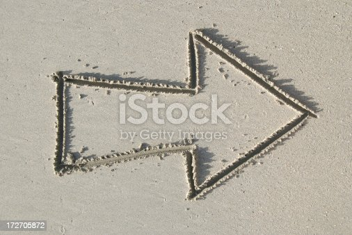 istock Outline Arrow in the Sand 172705872
