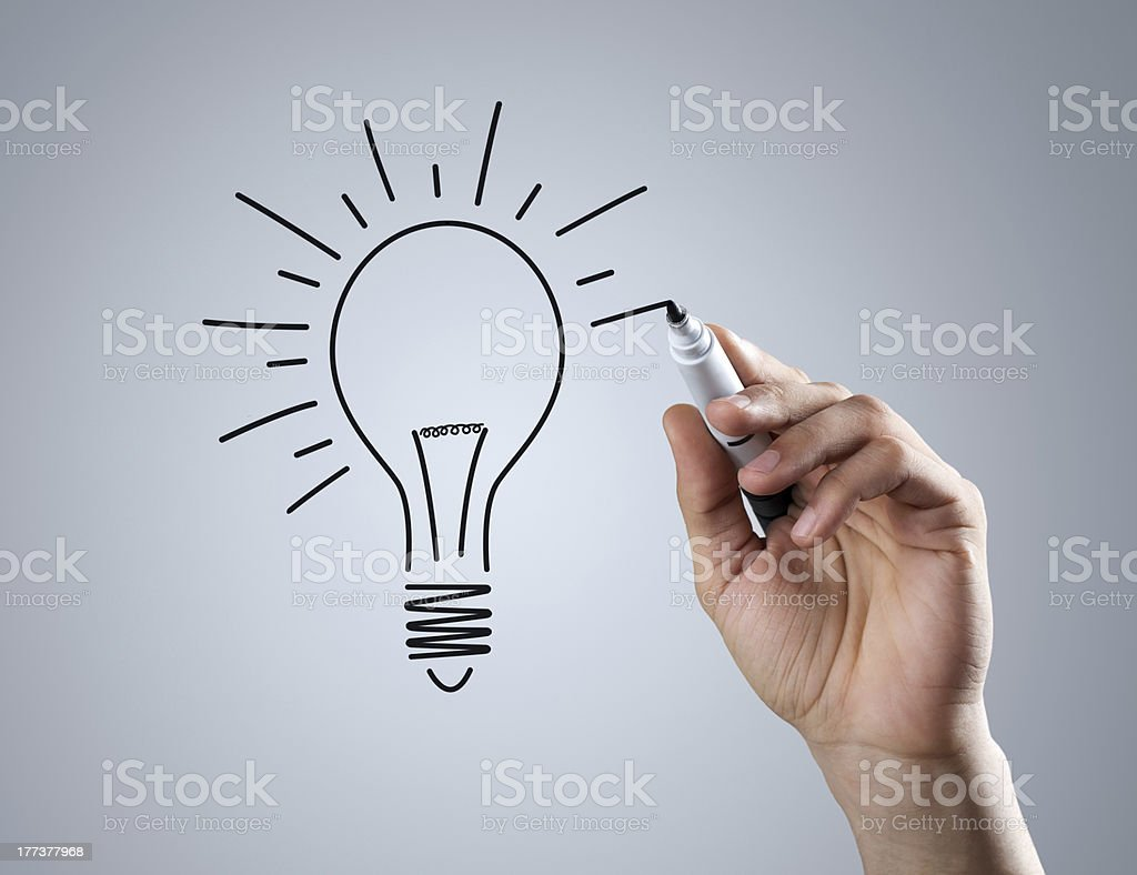 Outline drawing of a light bulb with black marker pen stock photo