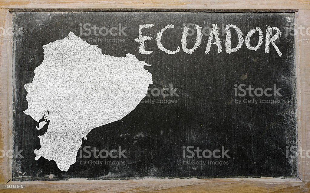 outline map of ecuador on blackboard stock photo