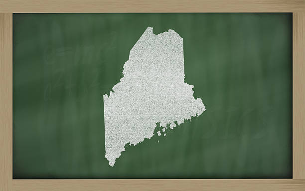outline map of maine on blackboard stock photo