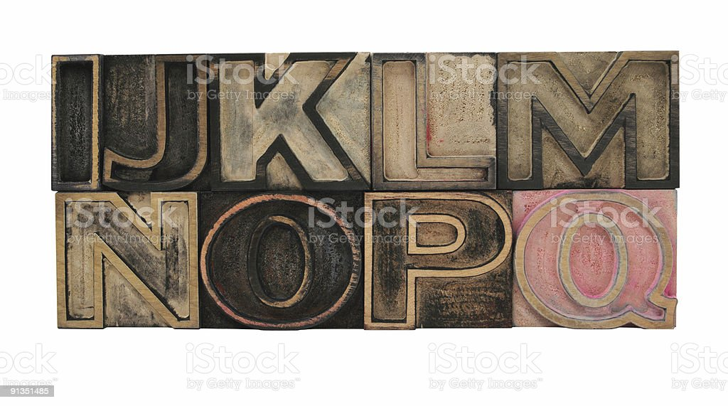 outline wood letters I-Q stock photo